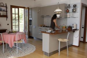 A kitchen or kitchenette at Al Veluu suites