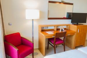 A television and/or entertainment center at AR Diamante Beach Spa Hotel