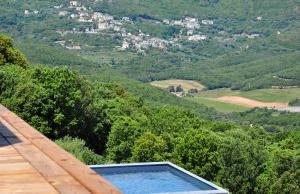 The swimming pool at or near Le Tomino