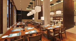 A restaurant or other place to eat at DoubleTree By Hilton-Pune Chinchwad