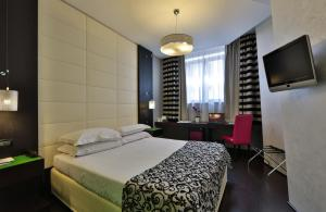 A bed or beds in a room at Best Western Cinemusic Hotel
