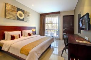 A bed or beds in a room at Amadea Resort & Villas Seminyak Bali