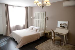 Un ou plusieurs lits dans un hébergement de l'établissement La Maison d'Hotes de Saint Leger