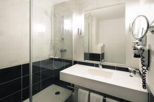 Salle de bains dans l'établissement Hôtel Mercure Lyon Centre Charpennes