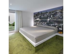 A bed or beds in a room at Granada Five Senses Rooms & Suites