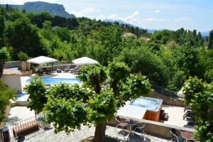 A view of the pool at Hôtel Le Colombier or nearby