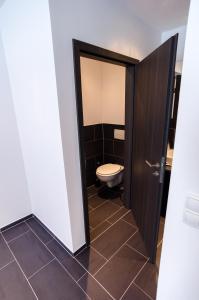 Ein Badezimmer in der Unterkunft 3H Apartments