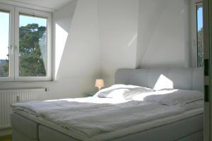 Ein Bett oder Betten in einem Zimmer der Unterkunft Ferienappartement Barfuss