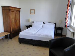 Кровать или кровати в номере Pension Villa am Burgberg