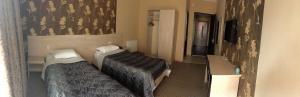 Кровать или кровати в номере Hotel Elio