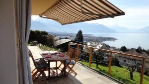 Ein Balkon oder eine Terrasse in der Unterkunft La Renardière