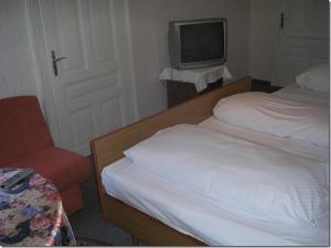 Ein Bett oder Betten in einem Zimmer der Unterkunft Gasthof Staudach