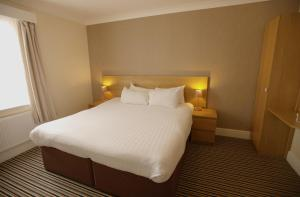 A bed or beds in a room at Ashley Victoria
