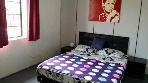 Cama o camas de una habitación en Jalan Jalan Guest House