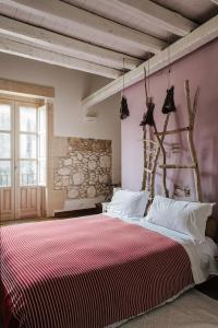A bed or beds in a room at B&B Palazzo Del Sale