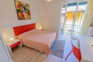 Кровать или кровати в номере Hotel Alpino