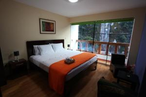 A bed or beds in a room at USGAR Machupicchu Boutique