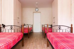 A bed or beds in a room at Voskhod