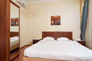 Ліжко або ліжка в номері Botanic Apartments Krasnoarmeyskaya