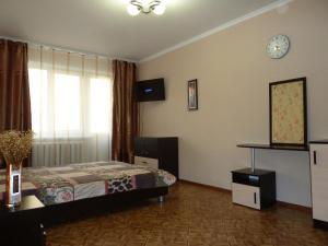 Кровать или кровати в номере Apartment Ordzhonikidze