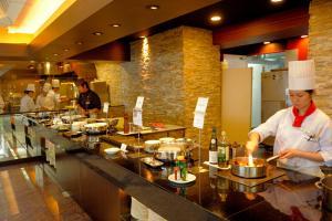 A restaurant or other place to eat at Okinawa Kariyushi Urban Resort Naha