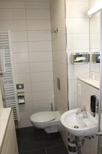Een badkamer bij Prime 20 Serviced Apartments