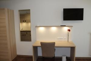 Een TV en/of entertainmentcenter bij Prime 20 Serviced Apartments