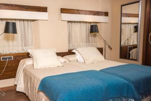 Cama o camas de una habitación en Hotel Villa de Cretas
