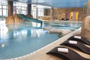 The swimming pool at or close to Dream Castle Hotel Marne La Vallee