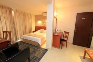 A bed or beds in a room at Triton Hotel Piraeus