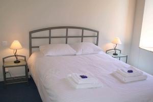 Un ou plusieurs lits dans un hébergement de l'établissement Hotel Bermond