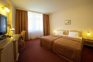 Postel nebo postele na pokoji v ubytování Interhotel Central