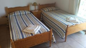 A bed or beds in a room at Pissouriana Apartments