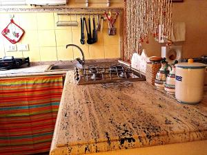 A kitchen or kitchenette at Casa Vacanze Seahorse