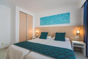 Cama o camas de una habitación en Aparthotel Holiday Center