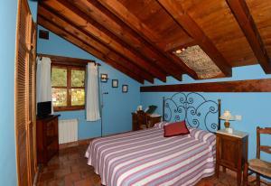 A bed or beds in a room at Hotel-Posada La Casa de Frama