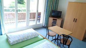 Ein Bett oder Betten in einem Zimmer der Unterkunft Hotel Fluematte