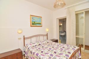Letto o letti in una camera di Hotel Villa Fiorentina