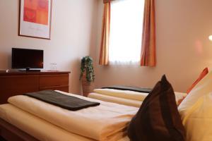 Ein Bett oder Betten in einem Zimmer der Unterkunft Hotel Checkin