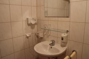 Ein Badezimmer in der Unterkunft Hotel Checkin