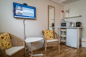 A television and/or entertainment center at GentleSpace Guesthouse