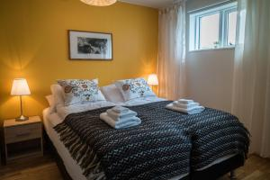 A bed or beds in a room at GentleSpace Guesthouse