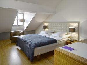 Letto o letti in una camera di The ICON Hotel & Lounge