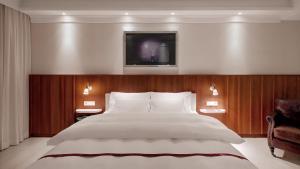 מיטה או מיטות בחדר ב-Ruby Sofie Hotel Vienna