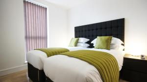 A bed or beds in a room at Andora Apartments