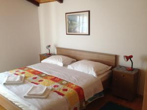 A bed or beds in a room at Apartments Mirela