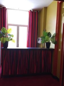 The lobby or reception area at Hôtel-Résidence Andemar