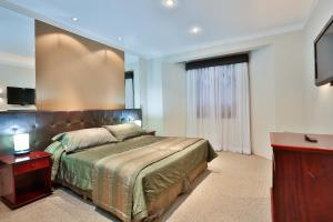 A bed or beds in a room at Home Green Home