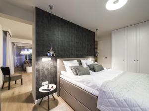Łóżko lub łóżka w pokoju w obiekcie Plenty