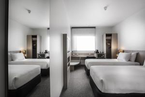 A bed or beds in a room at Ibis Mackay